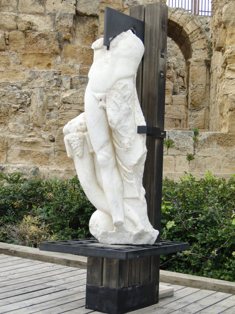 Display of headless statue of unknown figure found in Caesarea, Israel