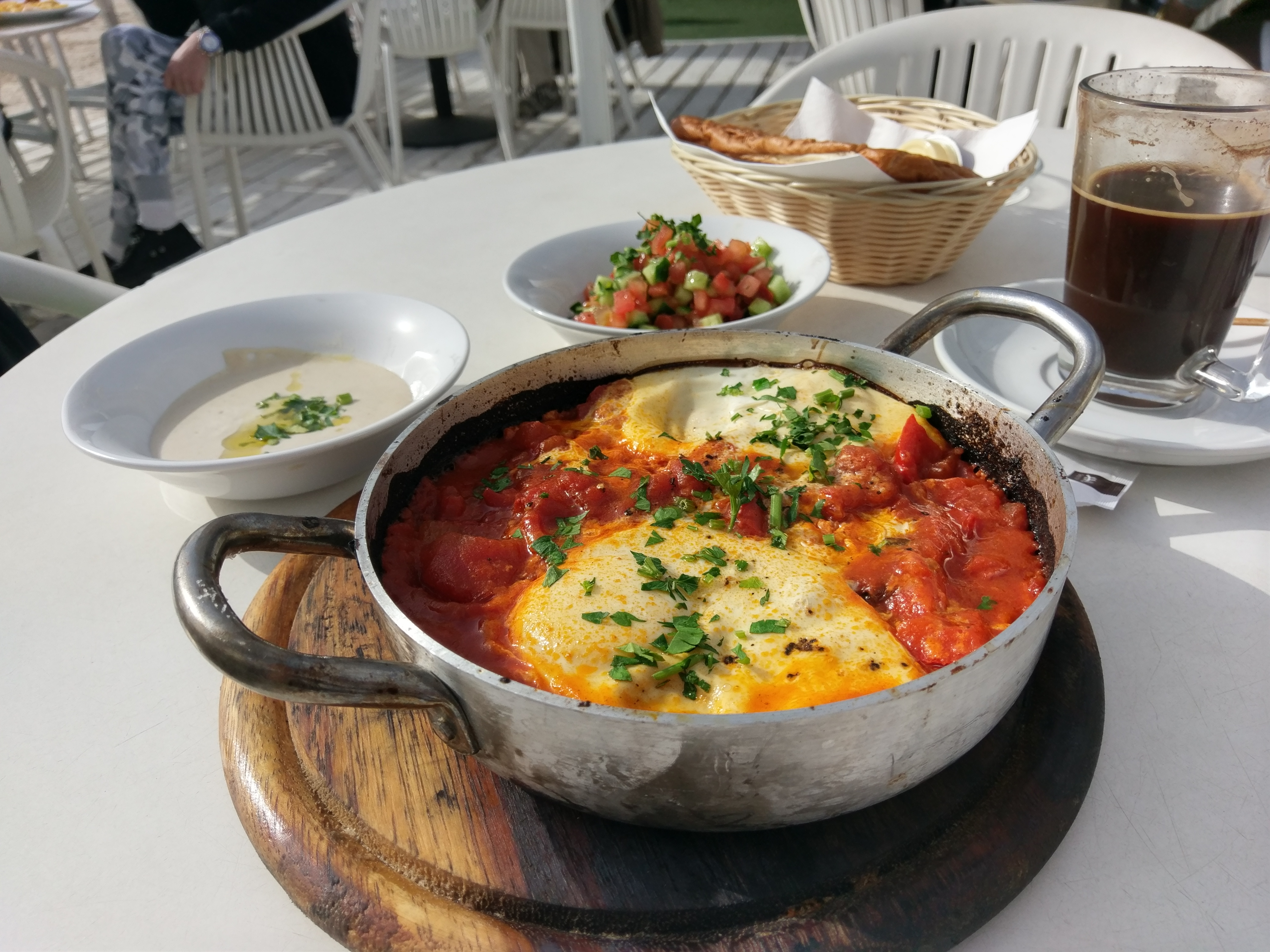 Typical Israeli Shakshuka breakfast dish - Hilton Beach area in Tel Aviv, Israel