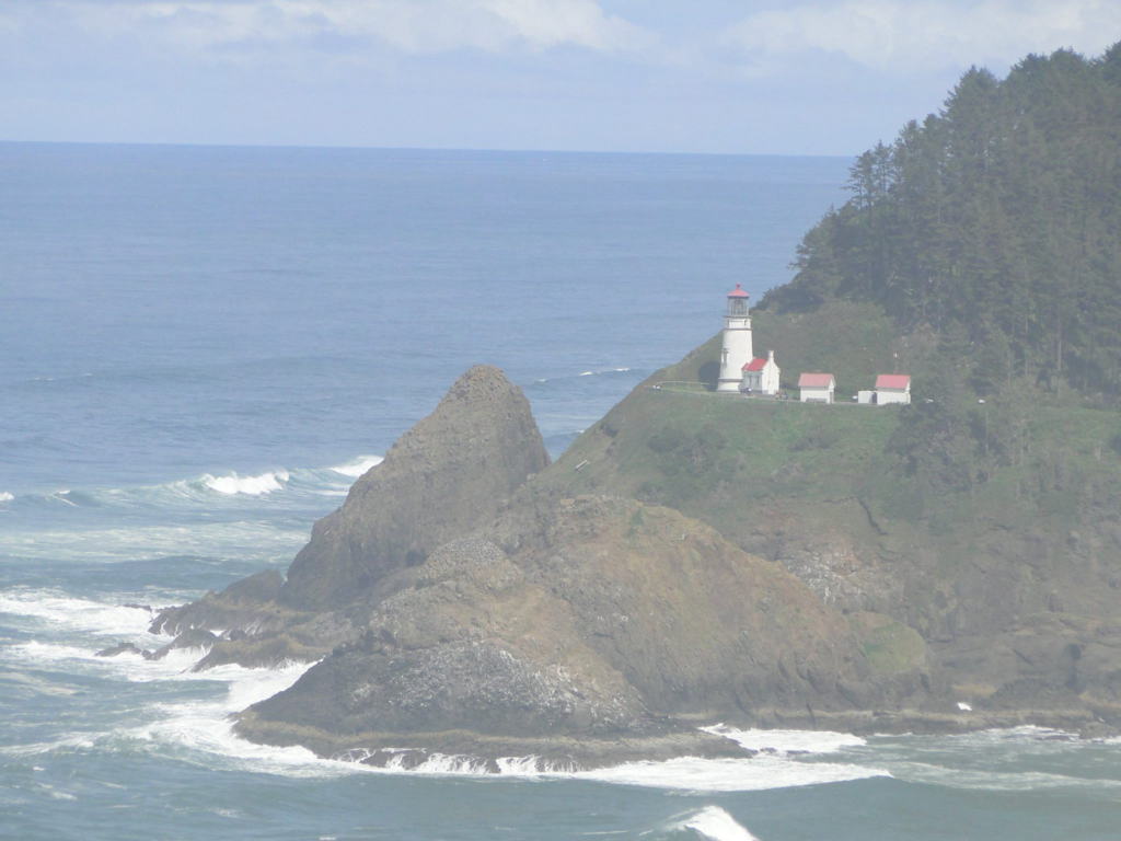 Lighthouse under thick mist nearby Florence, Oregon