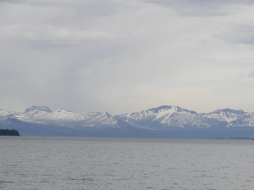 Lake Yellowstone with mountain range in the background - Yellowstone National Park